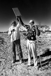 DECEMBER 18, 1984: (L-R) Aboriginal tribal elders Tommy Queama and Jack Baker hold the Maralinga land grant documents above their heads. The deeds give them 8 percent of SA. The local aborigines had been forced off the land in 1951 when Britain wanted the land for atomic (nuclear) weapons testing. (Photo by Milton Wordley / Newspix) Contact Email: www.newspix.com.au Contact Web URL: newspix@newsltd.com.au Contact Email: www.newspix.com.au